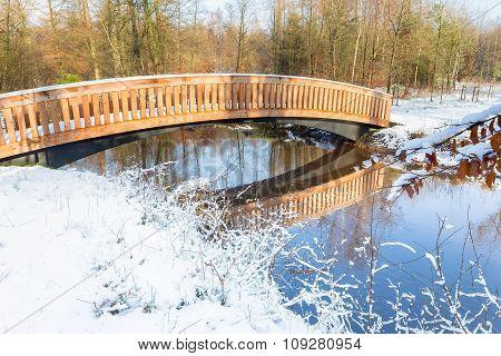 Wooden Bridge Snow And Water In Winter Season