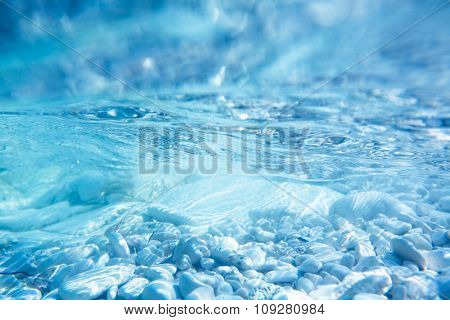 Underwater sea surface image with rock bottom. Marine background concept
