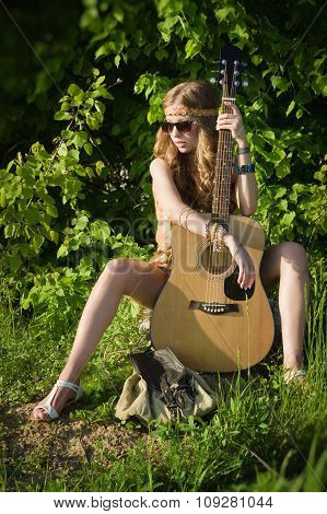 Attractive Girl Travelling With Her Guitar