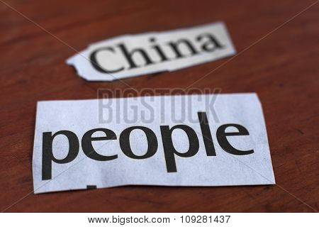 China people cut out label from the newspaper. Chinese domination concept