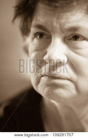 Senior closeup  portrait of older woman looking up