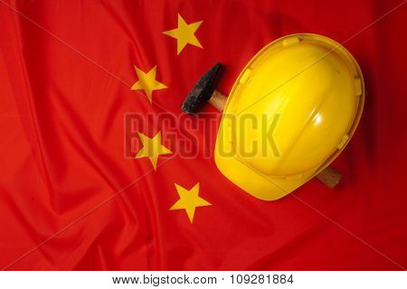 Yellow helmet covering the China flag symbol