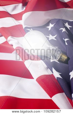Lightbulb on American flag. US innovation and development concept