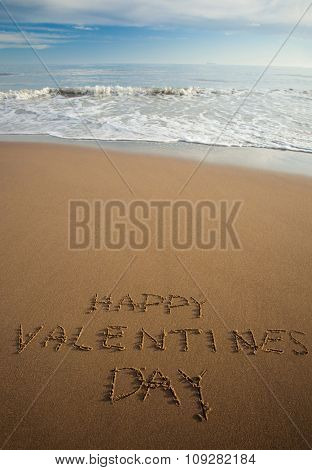 Happy Valentine`s day  written in sand on a beach