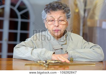 Lady touching lid of coffin