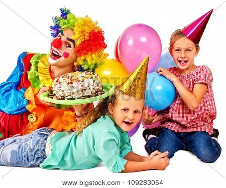 Clown holding cake on birthday with two female children. Isolated.