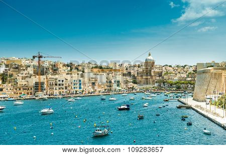 little yachts and boats from plan wiev to the bay near Valletta in Malta