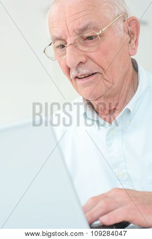 elderly man with a laptop
