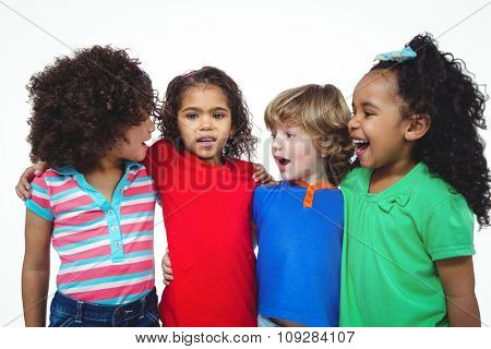 Four kids standing together in a line against a white background