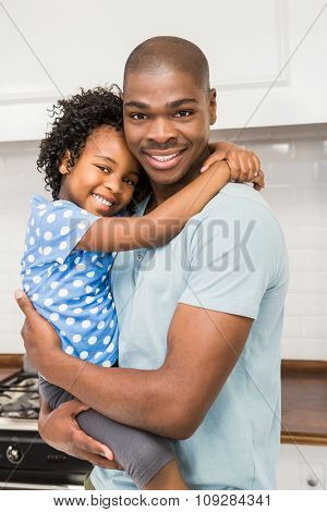 Father and daughter in the kitchen at home