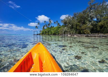 View of a colorful kayak in tropical ocean near exotic beach