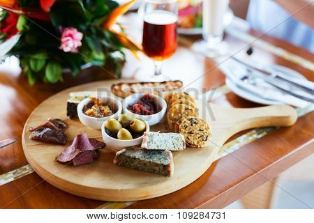 Selection of different delicious appetizers on beer platter