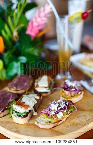 Different kinds of fresh homemade crispy Italian antipasto bruschettas