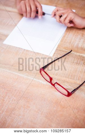Close up view of a piece of paper on wooden desk