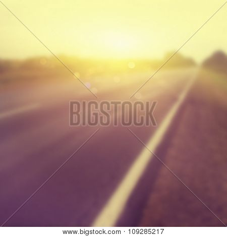 Abstract blurred background of country road at sunset.