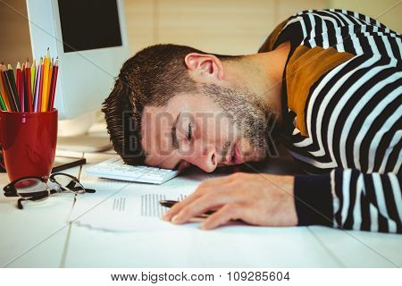 Man asleep at his desk in his office