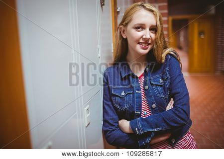 Smiling student leaning against the locker at the university