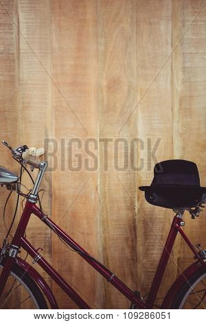 Close up view of a bicycle against wooden background