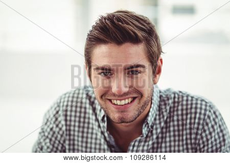 Smiling casual business man in casual office
