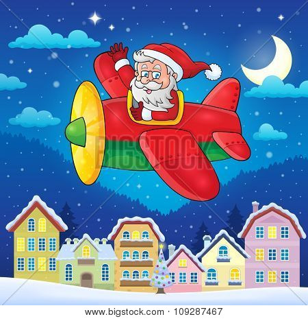 Christmas town with Santa Claus in plane - eps10 vector illustration.