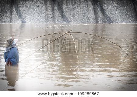 fisherman in water