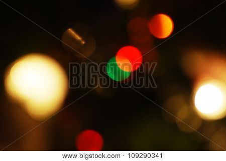 Yellow, Dark And  Red Background With Christmas Lights In Boken