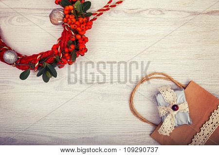 Christmas background on wooden table and copy space, shopping bag