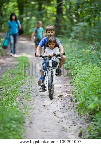 Children On A Bicycle