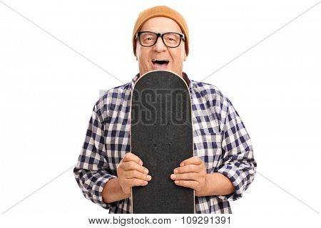 Joyful senior skater holding a skateboard and looking at the camera isolated on white background