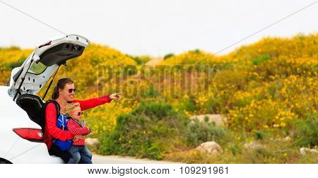mother and little daughter travel by car