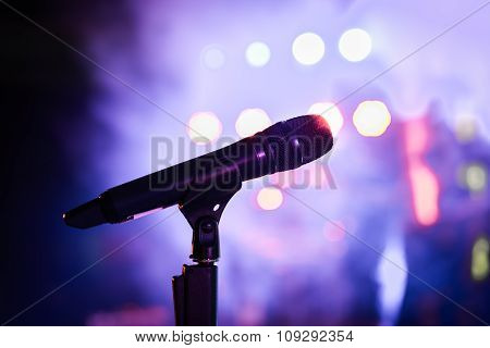 Wireless Microphone Stand On The Stage Venue With Blur Bokeh Background