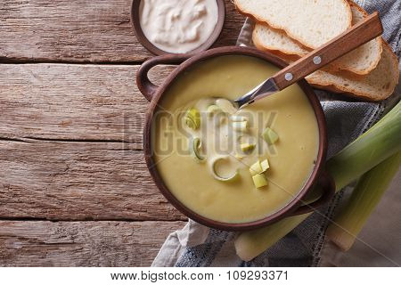 Leek Puree Soup With Sour Cream On The Table. Horizontal Top View