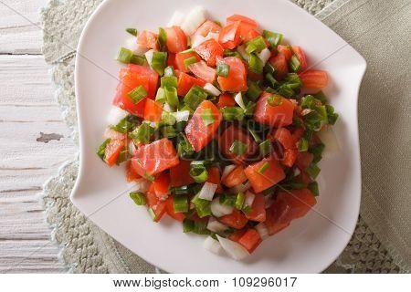 Hawaiian Lomi Lomi Salad Close-up On The Table. Horizontal Top View
