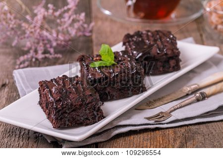 Cake Chocolate Brownies With Dark Chocolate  Dressing And Mint