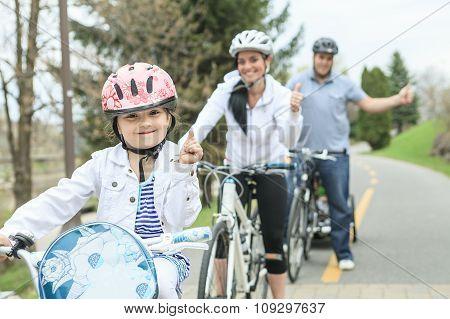 Family having fun on bikes