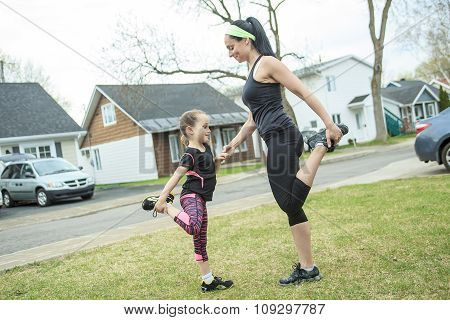 Mother and daughter doing exercises together