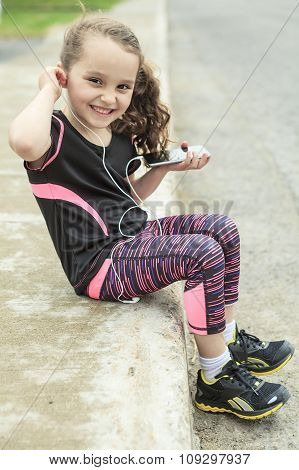 Young girl street jogging