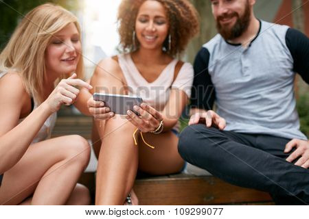 Young Friends Using Mobile Phone