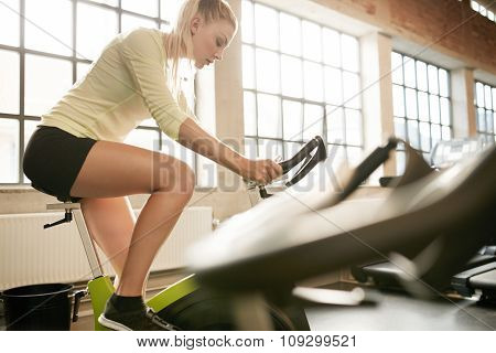 Attractive Woman Doing Fitness On A Stationary Bike