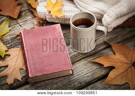 Warm clothes and a cup of tea on autumn day