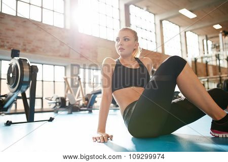 Young Woman Having Break In Fitness Club