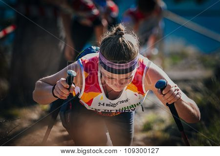 closeup face young woman athlete with nordic walking poles