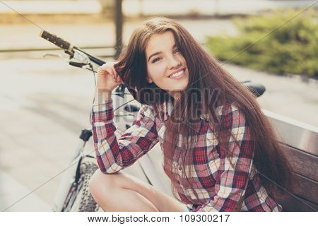 Young woman with long hair on a bicycle trip.