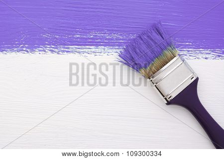 Stripe Of Purple Paint With A Paintbrush On White