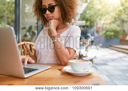 Woman At Sidewalk Cafe Reading Emails