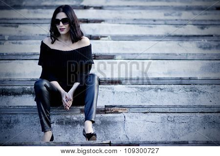 Woman On The Stadium Wearing Black