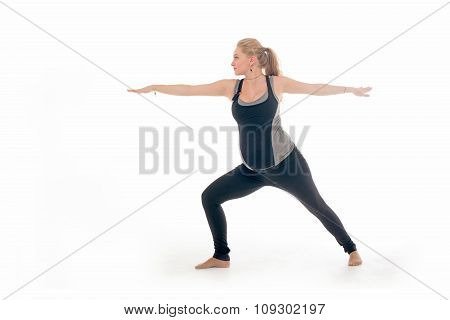 Pregnant woman doing sport exercises in yoga style