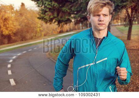 Runner Man Portrait In Autumn Park