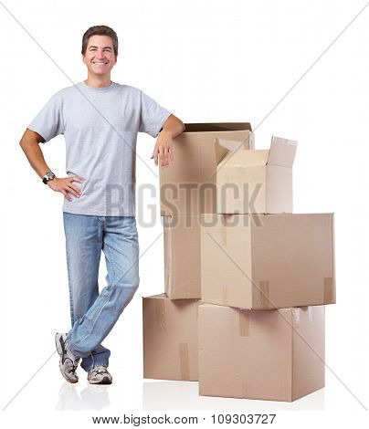 Handsome Man with moving boxes isolated over white background.