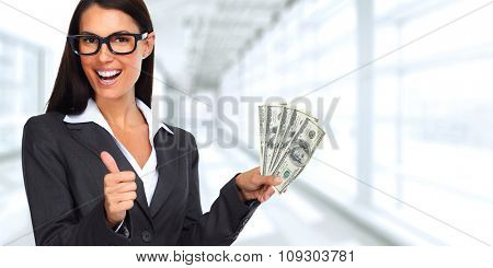 Happy laughing woman holding dollars over blue background